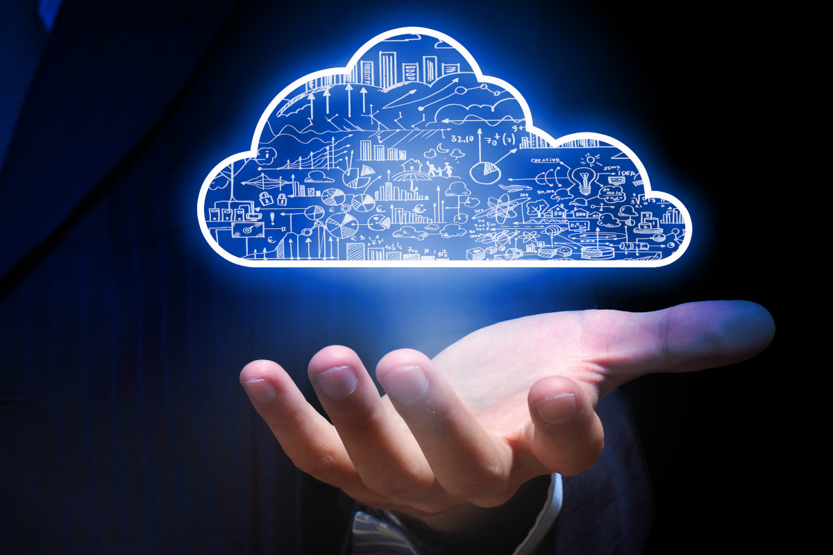 Close up of Businessman's Hand Holding Cloud Graphic Representing Computing